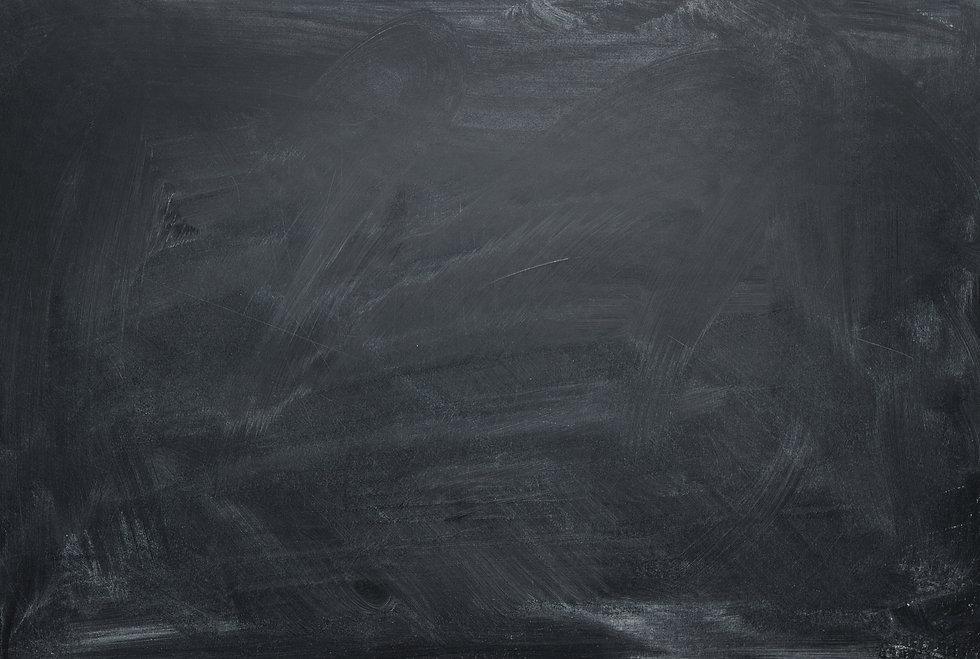 vecteezy_a-dusty-blank-chalkboard-with-p