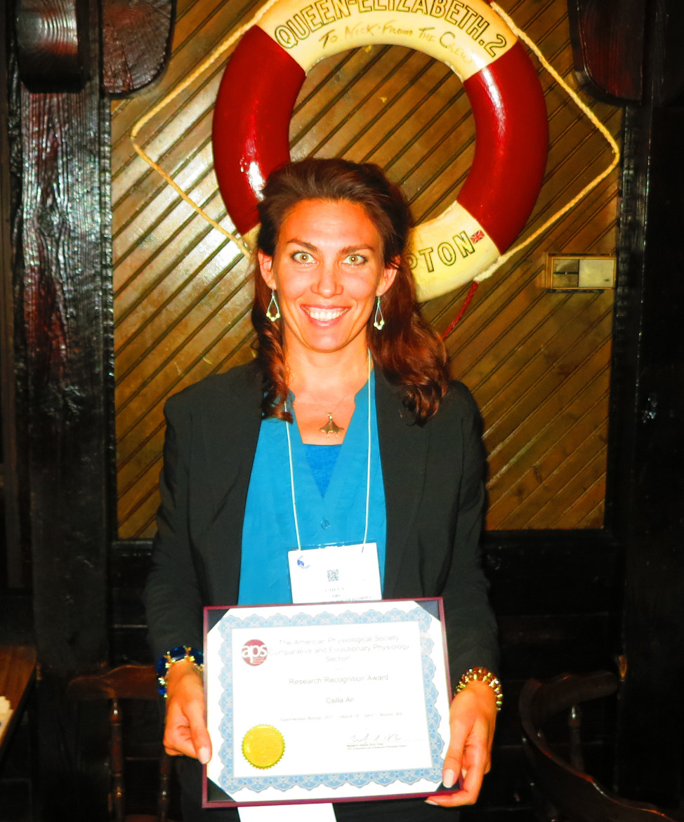 Dr. Csilla Ari with the Reseach Recognition Award after the award ceremony