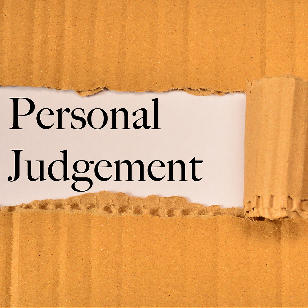 A yellow piece of cardboard has been peeled back to reveal the words Personal Judgement