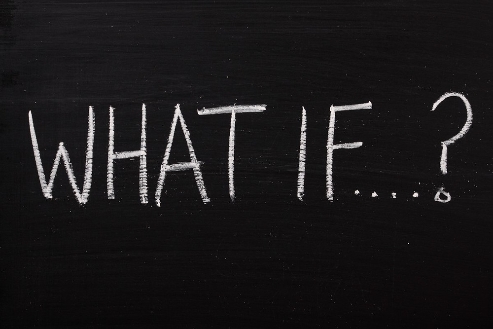 "A blackboard with the words ""What if?"" written in white chalk"