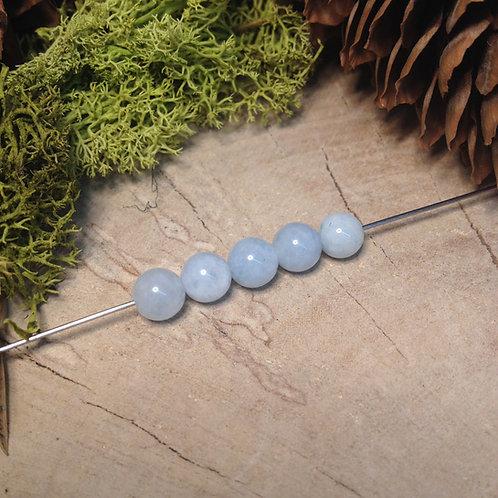 Perle aigue marine 6 / 6.5mm
