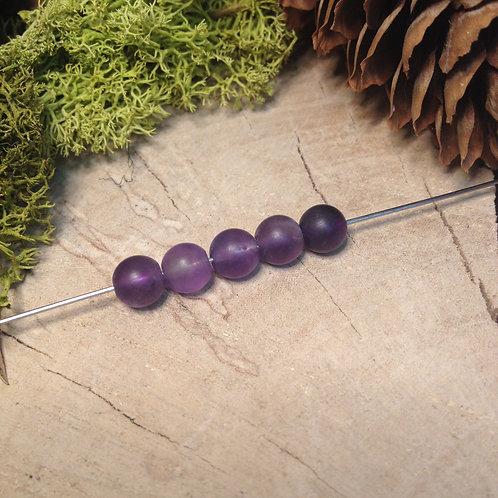 Perle améthyste dépolie 6 / 6.5mm