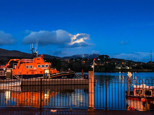 The moon rising over Castletownbere Lifeboat