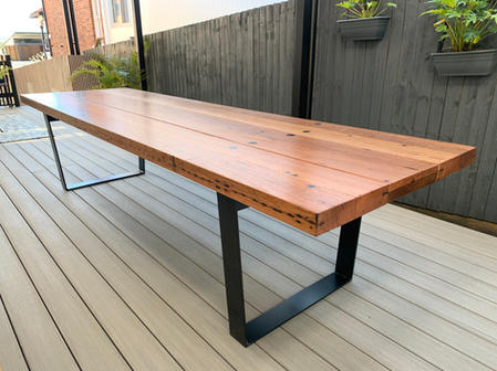 Recycled hardwood outdoor table with steel base