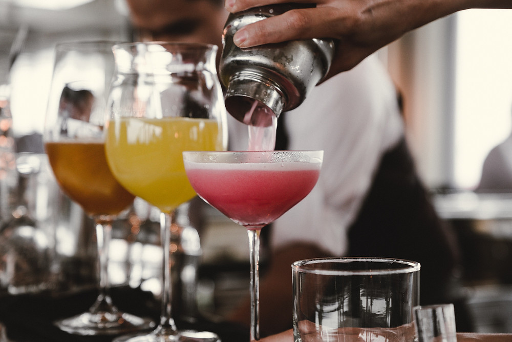 Cocktails being prepared on a bar