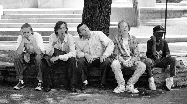 Five Montréal men sitting together in Phillips Square.