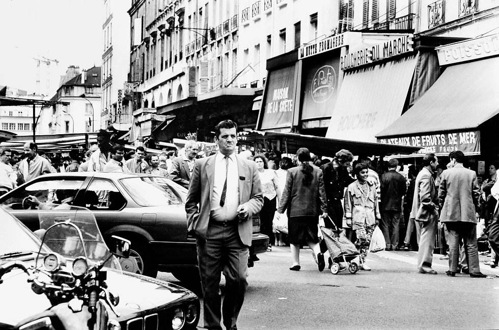 Large crowd of Parisian's shopping at busy street markets.