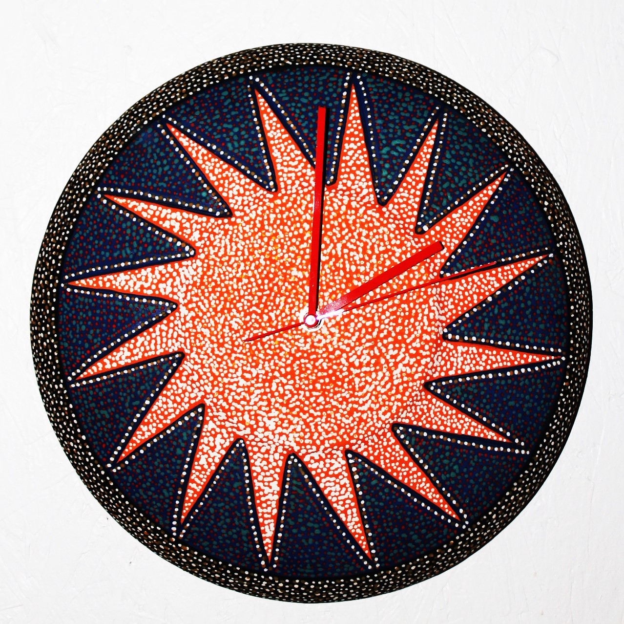 "Starburst Wall Clock 13""D, $65,00"