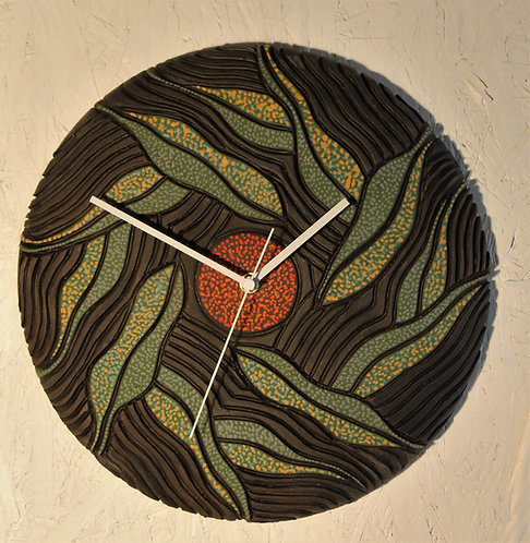 """Falling leaves"""" 13"""" D ceramic wall clock. Comes with 1 aa battery."""