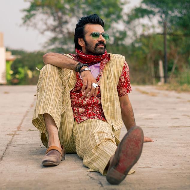 Avinash Tiwari wearing scarf