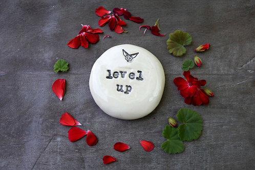 Level Up ceramic magnet