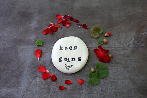 Keep Going ceramic magnet