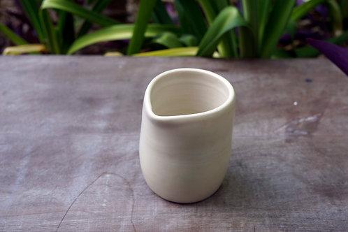 Tiny sand coloured ceramic jug