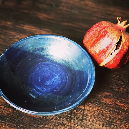 Homemade wheelthrown blue bowl with a half-matt finish