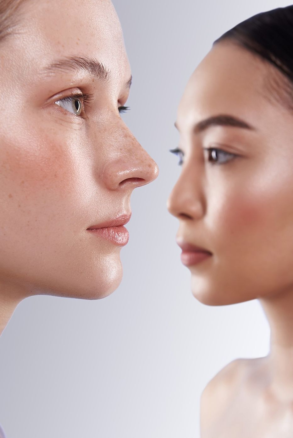 Two female faces looking into different directions