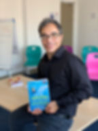 Cristian Cairo with his book The 10 Amazing Steps to Success