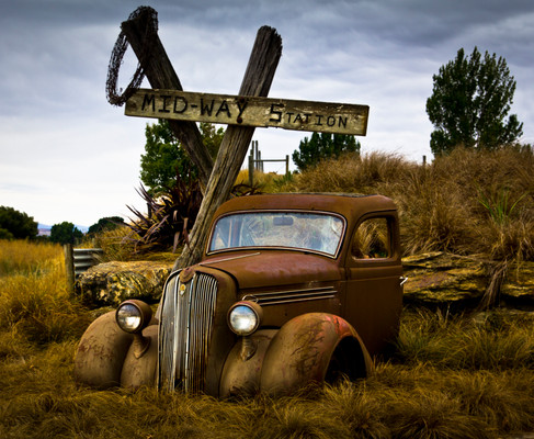 Old truck and cross by Martin McCrae