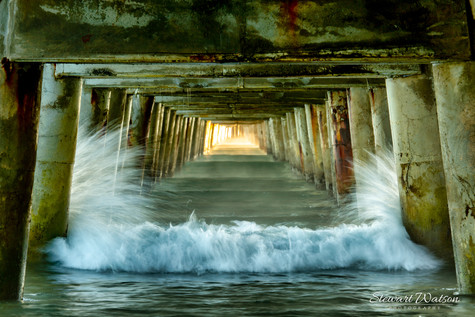 Freezing the waves under Tolaga Bay wharf by Stewart Watson
