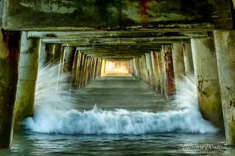 Freezing the waves under Tolaga Bay wharf by Stewart Watson