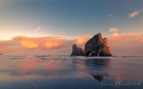 Sunrise at wharariki beach by Isaac Khasawneh