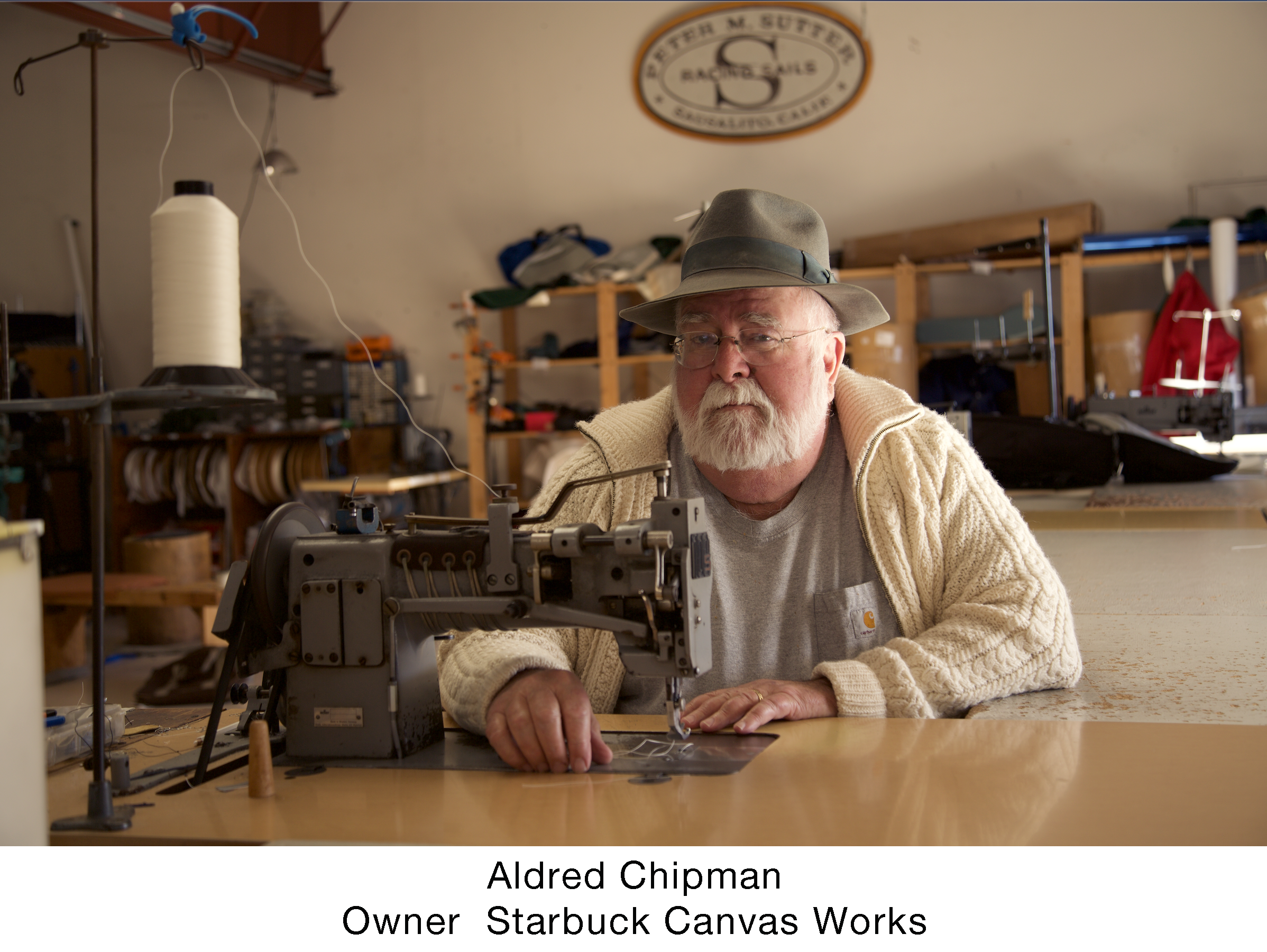 Aldred lorez at sewing machine.png