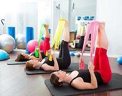women using thera bands pilates class