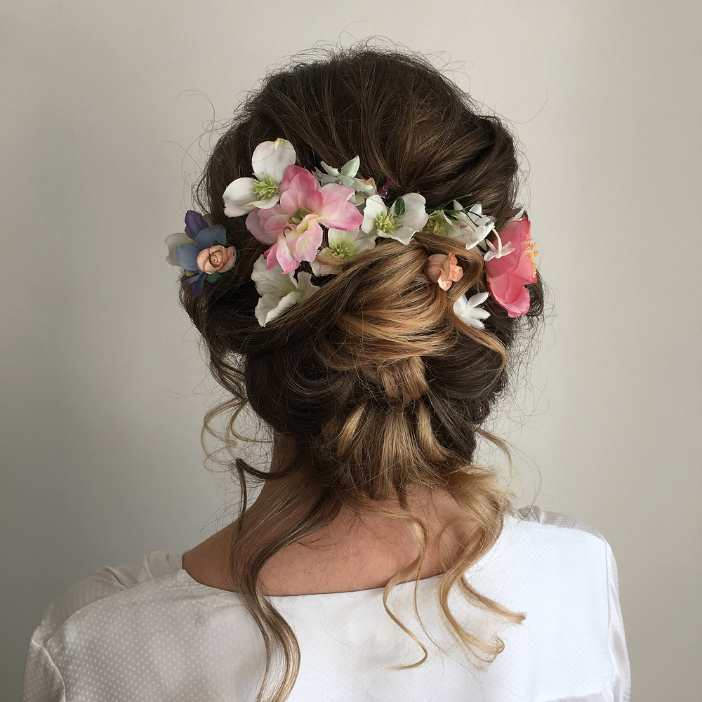 Boho wedding hairstyle with flowers