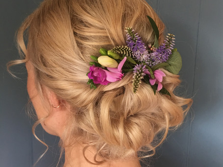 Flowers in her hair. Bridal hair inspiration for a summer wedding in Wiltshire.