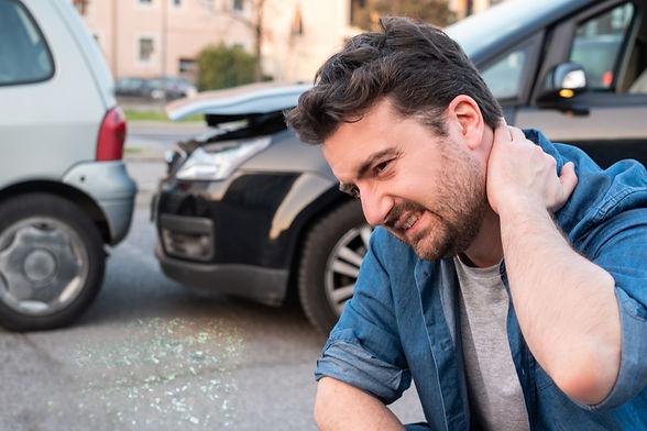 Driver portrait feeling pain after car a