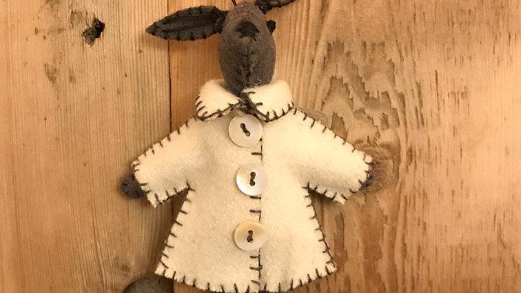 Rabbits in Jackets 'hanging and felt' (Thomas)
