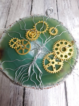 Steampunk gear tree of life on palm-sized agate, teal