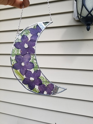 Pressed nicotiana flowers with leaves crescent moon