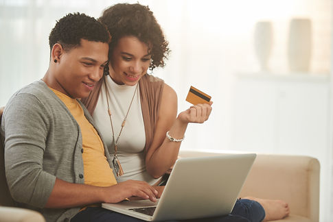 Latin-American couple shopping online at
