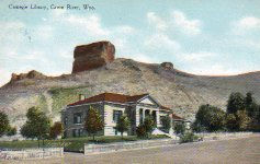 Green River, WY Carnegie library with bluff in background.
