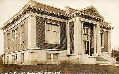 Exceptionally clear photo postcard of the Newberg, OR Carnegie building.