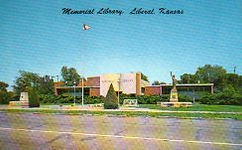 Liberal, KS public library with a mini-Statue of Liberty, and its entrance resembling an open book.