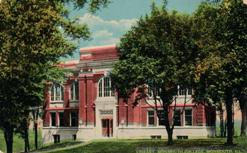 Curt Teich postcard, produced for F.W. Woolworth, of the Carnegie Library of Monmouth College.