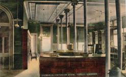 Interior view of the Sidney, Ohio library during its home in the GAR monumental building. Postcard mailed 1909.