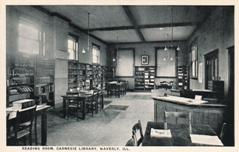 Interior of Waverly, IL Carnegie library with original service desk and wooden furniture