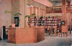 Interior of the Junction City, KS library, featuring a service desk and stacks.