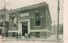 Bradford, PA Carnegie library with a group of people in front