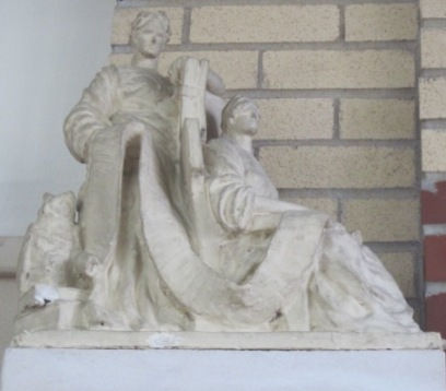Statue to the left of the fireplace in the Oregon, IL library.