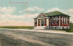 Miles City, MT Carnegie library, isolated on a dirt road