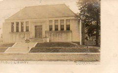 Photo postcard of the Bellvue Carnegie library, taken by J.H. Cave.