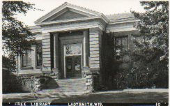 Ladysmith, WI Carnegie library photo postcard with typeset caption.