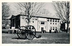Webster, MA public library with antique cannon in foreground