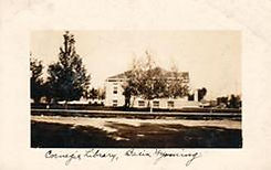 Basin, WY Carnegie library, shown on a Real Photograph postcard.