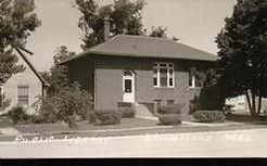 Bloomfield, NE Carnegie library on photo postcard.