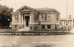 Early photo postcard of Janesville, MN's Carnegie library.