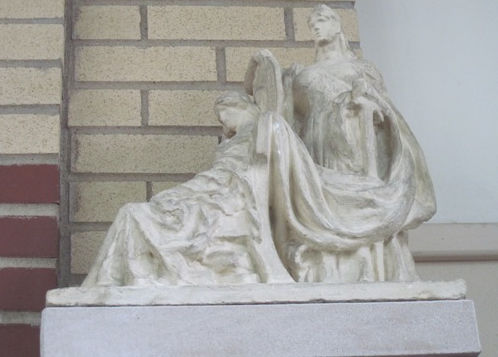 Statue to the right of the fireplace in the Oregon, IL library.